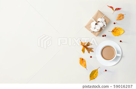 Autumn theme with a cup of coffee and a gift box 59016207
