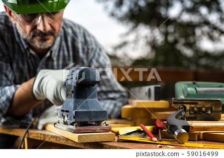 Craftsman at work on wooden boards. Carpentry. 59016499
