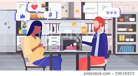 couple using online mobile app social media network chat bubble communication concept mix race man 59016925