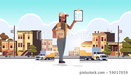 postwoman in uniform holding cardboard parcel box and receiving form african american courier 59017059