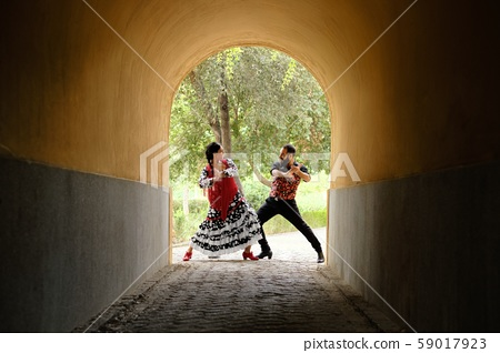 Man And Woman Dancing Flamenco In Traditional Clothes 59017923