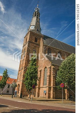 Steeple on the church facade made of bricks in Weesp 59018195