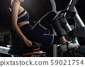 Muscular fitness woman exercises healthy lifestyle 59021754