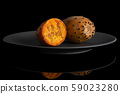 Fresh orange opuntia isolated on black glass 59023280