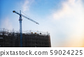 Construction of buildings with construction cranes 59024225