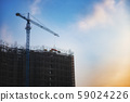 Construction of buildings with construction cranes 59024226