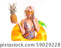 Photo of smiling beautiful woman wearing swimsuit standing in swim ring isolated white background 59029228