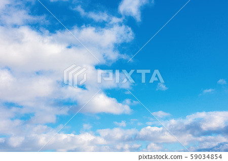 puffy clouds on the blue winter sky 59034854