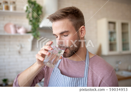 Bearded man feeling good while drinking cold water 59034953