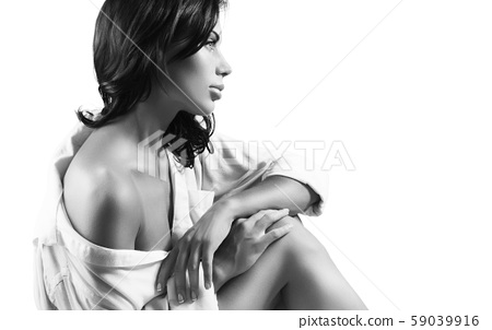 Pretty woman wearing men's shirt 59039916