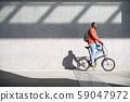 African Man Riding Folding Bike For Urban Commuting 59047972