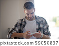Businessman texting his secretary at the weekend 59050837