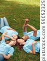 Volunteering. Young people volunteers outdoors lying resting laughing cheerful 59052325