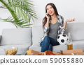 Young woman sport fan watching match talking using smartphone 59055880