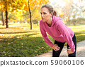 Healthy Lifestyle. Young woman standing outdoors autumn season breathing exhausted close-up 59060106