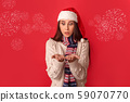 Celebration Concept. Young woman in scarf and santa hat standing isolated on red looking at palms 59070770