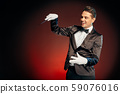 Professional Occupation. Showman in suit standing isolated on wall making trick with cane smiling 59076016