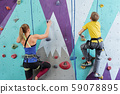 Back view of schoolboy and young woman in activewear grabbing by small rocks 59078895