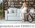 Senior woman at home retirement concept sitting phone call cheerful 59080232