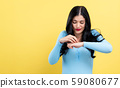 Young woman scratching her itchy arm. 59080677