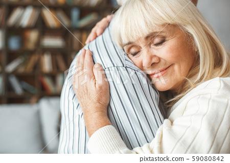 Senior couple together at home retirement concept dancing ballroom dance hugging close-up 59080842