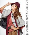 Amazing beautiful brunette woman in autumn color. 59081154