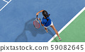 Young woman in blue shirt playing tennis. Youth, flexibility, power and energy. 59082645