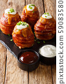 Grilled volcano potatoes wrapped in bacon topped 59083580