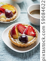 Mini tarts with cream and mix of summer fruit 59084622