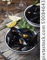 Cooked mussels with parsley 59084643