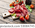 Italian antipasto with bresaola and red wine 59084745