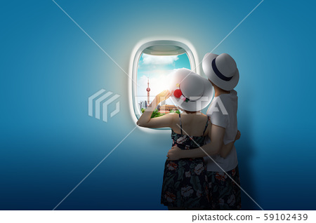 Traveling concept, looking out an airplane window 006 59102439