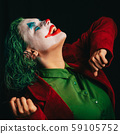 Make-up Joker with green hair for Halloween. Close-up face on black background.  59105752