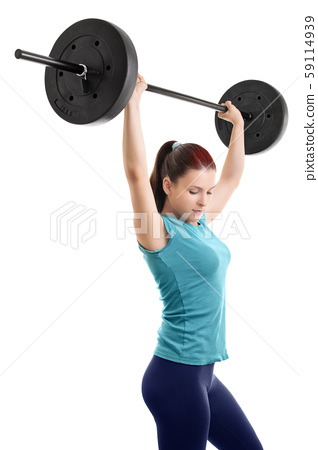 Young girl doing shoulder press with barbell 59114939