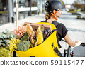 Courier delivering fresh products 59115477