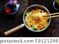 human hand mix  instant noodles with vegetables for quick vegan breakfast 59121206