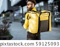 deliveryman with backpack outdooors 59125093