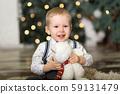 Portrait of a little boy play with teddy bear near 59131479