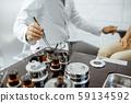 Otolaryngologist taking medical instruments 59134592