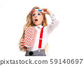 Small caucasian girl with makeup and long blonde hair with pop-corn and 3D glasses is shocked 59140697