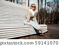 Pretty woman on bench at autumn park alone, lifestyle people concept 59141070
