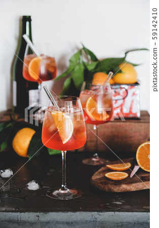 Aperol Spritz cocktail in glasses with oranges 59142410