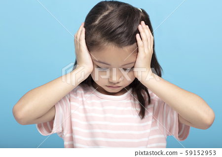 little girl with headache and problems 59152953