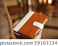Invitations, notepad, handmade notebook in the hands. 59163134