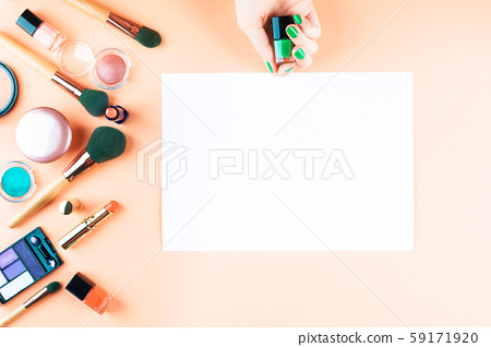 Make up items on orange. Flat lay with blank card 59171920