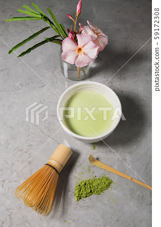 Ogranic green matcha tea drink and tea accessories - bamboo chasen on grey marble background. Japanese tea ceremony concept 59172308