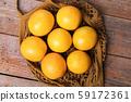 Top view of fresh organic oranges in string bag 59172361