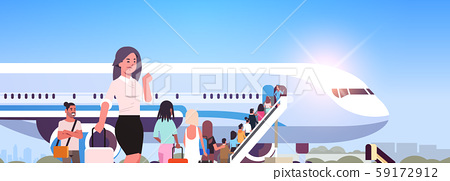 woman with luggage standing line queue of people travelers going to plane rear view passengers climb 59172912