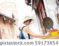 woman playing pinball in the old street at Lukang 59173654