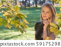 Portrait of seductive young girl posing in autumn 59175298